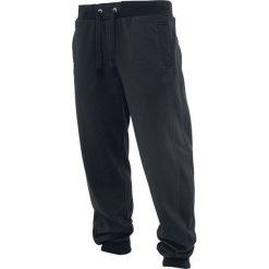 Urban Classics Straight Fit Sweatpants Spodnie dresowe czarny. Niebieskie spodnie dresowe męskie marki Urban Classics, l, z okrągłym kołnierzem. Za 121,90 zł.