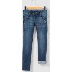 Dżinsy, krój skinny, 5 kieszeni 3-14 lat. Niebieskie jeansy dziewczęce IKKS JUNIOR, z bawełny. Za 335,96 zł.
