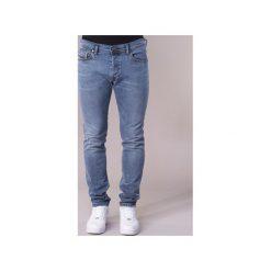 Jeansy slim fit Diesel  TEPPHAR. Niebieskie jeansy męskie relaxed fit marki Diesel. Za 559,20 zł.