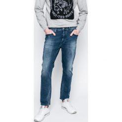 Diesel - Jeansy Jifer. Niebieskie jeansy męskie z dziurami Diesel. W wyprzedaży za 449,90 zł.