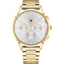 """Zegarek kwarcowy """"Emmy"""" w kolorze srebrno-złotym. Żółte, analogowe zegarki damskie TOMMY HILFIGER, ze stali. W wyprzedaży za 545,95 zł."""