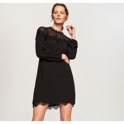 Sukienka z koronkową lamówką - Czarny. Czarne sukienki koronkowe marki Reserved. Za 69,99 zł.