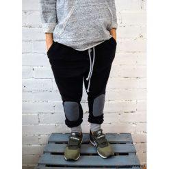 Odzież chłopięca: czarne spodnie typu jogger