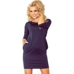 Olivia sukienka z kieszeniami - granatowa lacosta. Niebieskie sukienki na komunię marki numoco, na imprezę, s, w kwiaty, z jeansu, sportowe, sportowe. Za 99,99 zł.