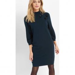 Dzianinowa sukienka ze stójką. Brązowe sukienki dzianinowe marki Orsay, s. Za 119,99 zł.