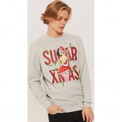 Bluza ze świątecznym motywem - Szary. Czarne bluzy męskie marki KIPSTA, z poliesteru, do piłki nożnej. Za 89,99 zł.
