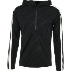 J.LINDEBERG CALIN Koszulka sportowa black. Czarne koszulki sportowe męskie J.LINDEBERG, m, z materiału, z długim rękawem. Za 379,00 zł.