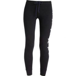 Bryczesy damskie: Sundry SKINNY STAR PATCHES Spodnie treningowe black