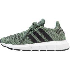 Adidas Originals SWIFT RUN  Tenisówki i Trampki trace green/core black/footwear white. Zielone tenisówki męskie marki adidas Originals, z materiału. Za 279,00 zł.