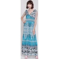 Sukienki hiszpanki: Miętowa Sukienka Buterflies Wings