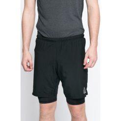 Reebok - Szorty. Czarne spodenki sportowe męskie Reebok, z elastanu, sportowe. W wyprzedaży za 129,90 zł.