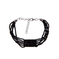 Czarna bransoletka z koralików QUIOSQUE. Czarne bransoletki damskie na nogę QUIOSQUE. W wyprzedaży za 16,00 zł.