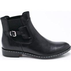 Carinii - Botki. Czarne buty zimowe damskie Carinii, z gumy, na obcasie. W wyprzedaży za 199,90 zł.