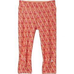 Spodnie dresowe damskie: Adidas Spodnie damskie Supernova 3/4 Tight pomarańczowe r. L (AI3274)