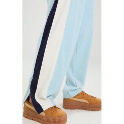 Fenty PUMA by Rihanna TRACK Spodnie treningowe sterling bluevanilla ice. Niebieskie spodnie dresowe damskie Fenty PUMA by Rihanna, s, z bawełny. W wyprzedaży za 455,40 zł.