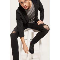 Rurki męskie: Jeansy slim fit z dziurami - Czarny