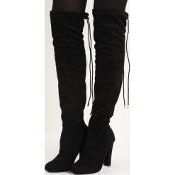 Czarne Kozaki Stay Up. Czarne buty zimowe damskie marki Born2be, z materiału, na wysokim obcasie, na obcasie. Za 89,99 zł.