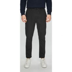 Tommy Jeans - Spodnie Randy. Szare chinosy męskie Tommy Jeans, z bawełny. Za 299,90 zł.