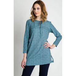 Bluzki asymetryczne: Turkusowa bluzka wiązana pod szyją BIALCON