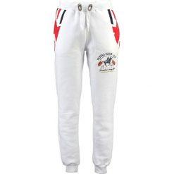 """Spodnie dresowe """"Moduk"""" w kolorze białym. Białe joggery męskie marki Geographical Norway, z aplikacjami, z dresówki. W wyprzedaży za 117,95 zł."""