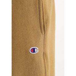 Spodnie dresowe męskie: Champion Reverse Weave STRAIGHT WEAVE TRACK PANTS Spodnie treningowe dark yellow
