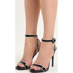 Czarne Sandały Stinger. Czarne sandały damskie Born2be, w paski, na wysokim obcasie. Za 49,99 zł.