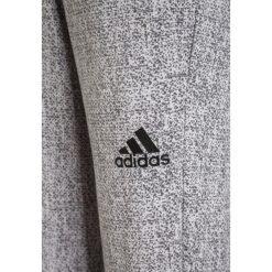 Adidas Performance Spodnie treningowe light solid grey/grey three/black. Szare spodnie chłopięce adidas Performance, z bawełny. W wyprzedaży za 127,20 zł.