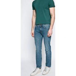 Tommy Hilfiger - Jeansy Denton. Niebieskie jeansy męskie z dziurami marki TOMMY HILFIGER. W wyprzedaży za 379,90 zł.