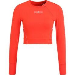 Adidas by Stella McCartney TRAIN CLIMACHILL Koszulka sportowa coral red. Czerwone t-shirty damskie adidas by Stella McCartney, l, z elastanu, z długim rękawem. W wyprzedaży za 227,40 zł.