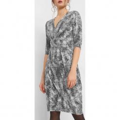 Sukienka z wężowym wzorem. Czarne sukienki dzianinowe marki KIPSTA, m, z długim rękawem, na fitness i siłownię. Za 99,99 zł.