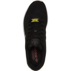Adidas Originals ZX FLUX Tenisówki i Trampki black. Czarne tenisówki damskie adidas Originals, z materiału. W wyprzedaży za 350,10 zł.