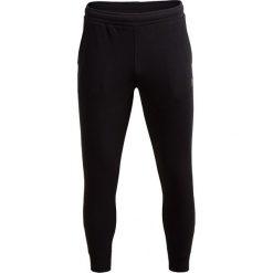 Spodnie dresowe męskie SPMD600 - CZARNY - Outhorn. Czarne spodnie dresowe męskie Outhorn, na jesień, z dresówki. W wyprzedaży za 48,99 zł.