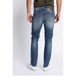 Lee - Jeansy Rider Blue Surrender Baza. Niebieskie jeansy męskie slim Lee, z aplikacjami, z bawełny. Za 319,90 zł.