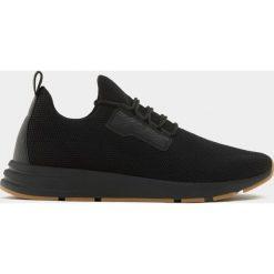 Buty skate męskie: Czarne buty sportowe z elastycznego materiału z siateczką