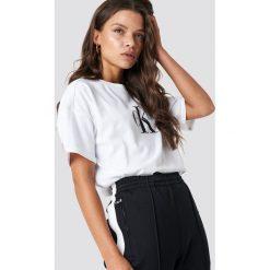 Calvin Klein T-shirt Teco True Icon - White. Białe t-shirty damskie Calvin Klein, z nadrukiem, z bawełny. Za 202,95 zł.