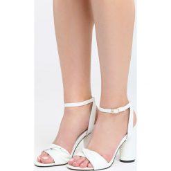 Białe Sandały Optimistic. Białe sandały damskie na słupku marki Born2be, z materiału, na wysokim obcasie. Za 89,99 zł.
