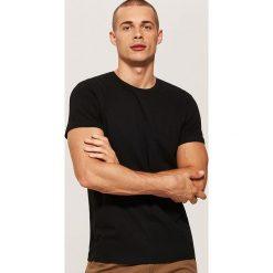 T-shirt basic - Czarny. Czarne t-shirty męskie marki KIPSTA, z poliesteru, do piłki nożnej. Za 25,99 zł.