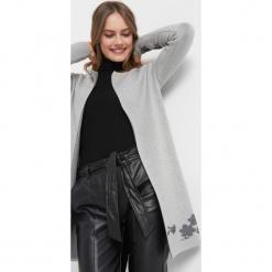 Kardigan z kwiatowym wzorem. Czarne kardigany damskie marki Orsay, xs, z bawełny, z dekoltem na plecach. Za 139,99 zł.
