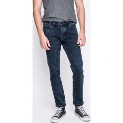 Wrangler - Jeansy. Niebieskie jeansy męskie z dziurami Wrangler. W wyprzedaży za 229,90 zł.