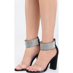 Czarne Sandały Snobbish. Czarne sandały damskie na słupku marki Born2be, z materiału, na wysokim obcasie. Za 89,99 zł.
