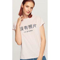 T-shirt z nadrukiem - Fioletowy. Fioletowe t-shirty damskie marki DOMYOS, l, z bawełny. Za 29,99 zł.
