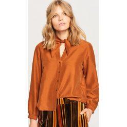 Koszula z lyocellem - Pomarańczo. Pomarańczowe koszule damskie Reserved, z lyocellu. Za 139,99 zł.