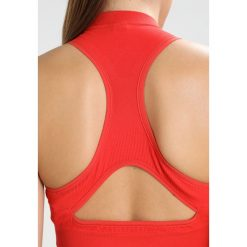 Topy sportowe damskie: adidas by Stella McCartney TRAIN CROP Top red
