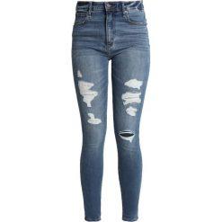 Abercrombie & Fitch SIMONE Jeans Skinny Fit medium destroy. Szare jeansy damskie relaxed fit Abercrombie & Fitch, z bawełny. Za 409,00 zł.