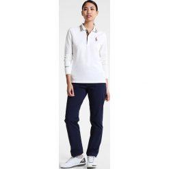 Polo Ralph Lauren Golf VAL Koszulka polo classic ivory. Białe topy sportowe damskie Polo Ralph Lauren Golf, xs, z bawełny. W wyprzedaży za 307,30 zł.