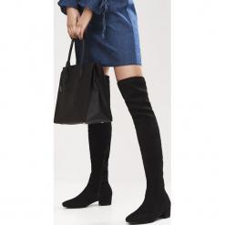 Czarne Kozaki Decorous. Czarne buty zimowe damskie Born2be, z materiału, z okrągłym noskiem, na obcasie. Za 159,99 zł.