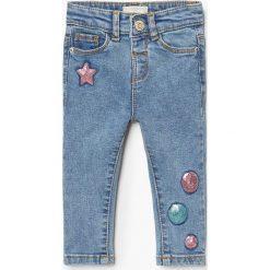 Mango Kids - Jeansy dziecięce Sequi 80-104 cm. Niebieskie rurki dziewczęce Mango Kids, z aplikacjami, z bawełny. Za 79,90 zł.