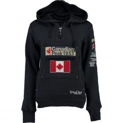 """Bluza """"Gyrelle"""" w kolorze granatowym. Niebieskie bluzy rozpinane damskie marki Canadian Peak, s, z aplikacjami, prążkowane, z krótkim rękawem, krótkie. W wyprzedaży za 136,95 zł."""