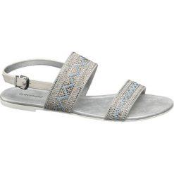 Sandały damskie Graceland beżowe. Brązowe sandały damskie marki Graceland, w geometryczne wzory, z materiału, na obcasie. Za 99,90 zł.