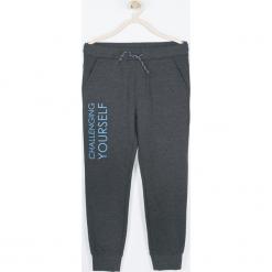 Spodnie. Czarne spodnie chłopięce TECHNOLOGY OF TOMORROW, z nadrukiem, z bawełny. Za 65,90 zł.